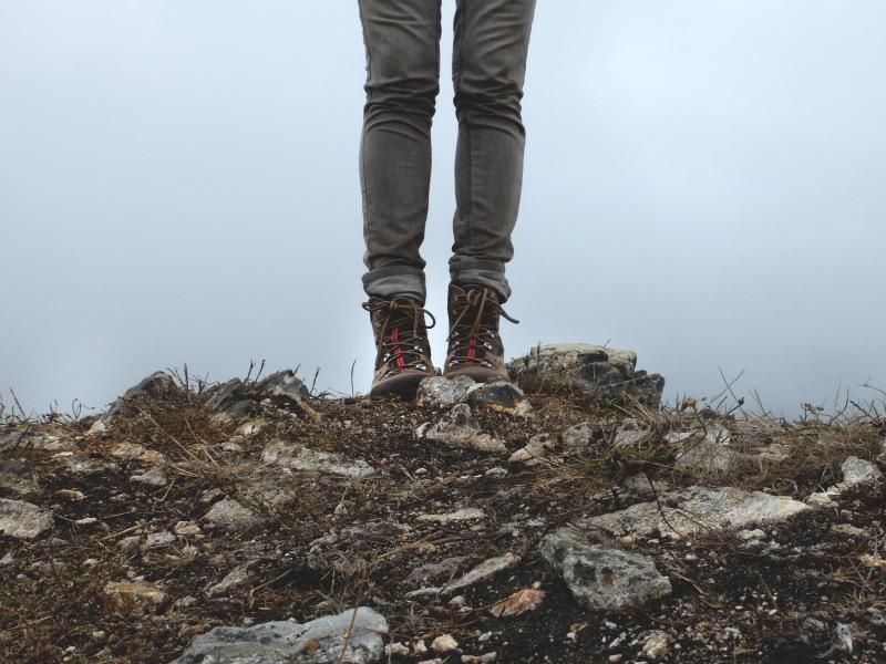 woman hiking boots on rocks